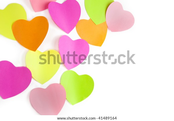 colors note papers hearts on white wall /  with copy space for your text
