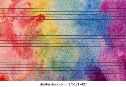 Colors of rainbow. Melody concept. Old music sheet in colorful watercolor paint. Music concept. Abstract colorful watercolor background.