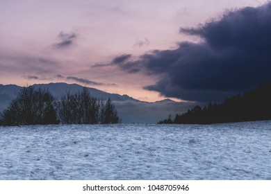 The colors of the sky during sunset with clouds in Austria. Love the white - purple contrast.