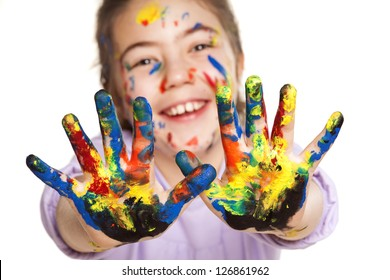 colors stained happy and smiling little girl showing ten fingers on white background