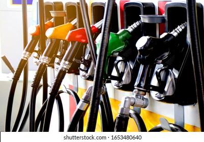 colorul fuel gasoline dispenser with sun flare background