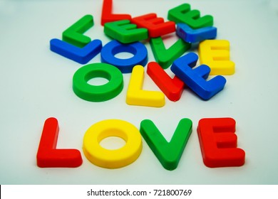 Colorul plastic letters spelling text LOVE on white background
