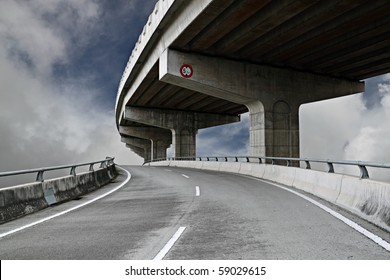 A colossal concrete motorway flyover access and egress.