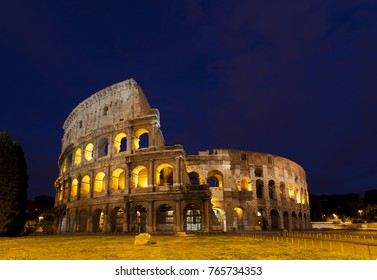 Colosseum Amphitheater in Rome, Italy during twilight and sunset.