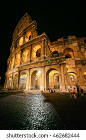 Colosseum in city center of Rome, Italy at night. Coliseum is an amphiteatre in Rome. It is the biggest one in the world. Rome is the capital of Italy.