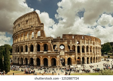 Colosseum in a cloudy day, the world known landmark and the symbol of Rome, Italy.
