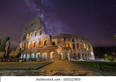 Colosseum (Coliseum), The Arena of Life And Death of The Rome Gladiators at night with blue stars sky. Flavian Amphitheatre in Rome (Roma), Italy Colosseum at night under the amazing milky way