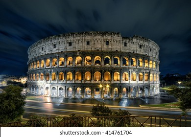 Colosseum or Coliseum at night, Rome, Italy. Roman Colosseum is one of the main travel attractions in Rome. Historical architecture in central Rome. Night panoramic view of Colosseum in lights.