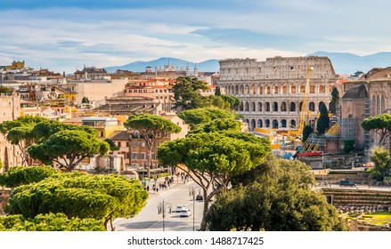 Colosseum (Coliseum) in Rome, Italy, Europe. It is the main travel attraction of Rome. Panoramic scenic view of Rome with Colosseum in summer.