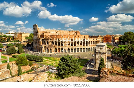Colosseum (Coliseum) in Rome, Italy, Europe. It is the main travel attraction of Rome. Panoramic scenic view of Rome with Colosseum in summer. Panorama of ancient Roman architecture in central Rome.