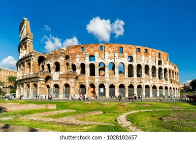 Colosseum or Coliseum, Rome, Italy. It is the main tourist attraction of Rome. Beautiful sunny panorama of Colosseum in summer. Ancient Roman ruins in central Rome. Postcard of Roma.