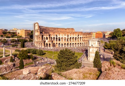 Colosseum (Coliseum) in Rome, Italy. Roman Colosseum is one of main travel attractions of Rome. Panoramic view of Coliseum area. Roma skyline. Historical architecture and ruins in central Rome.