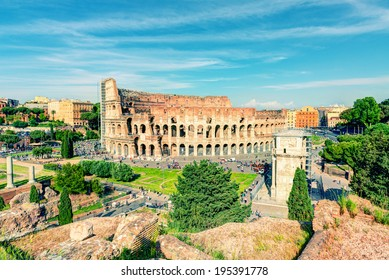 Colosseum (Coliseum) in Rome, Italy. Vintage Photo. Roman Colosseum is one of the main travel attractions of Rome. Panoramic view of Piazza del Colosseo with Coliseum. Ancient ruins in central Rome.