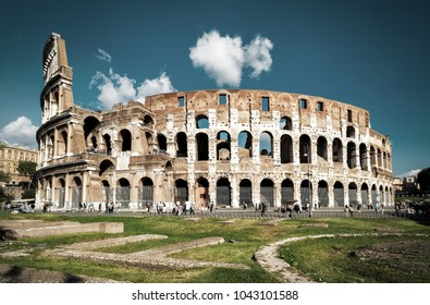 Colosseum or Coliseum in summer, Rome, Italy. Ancient Roman Colosseum is the main Italian tourist attraction and the largest amphitheater ever built. Scenic view of Colosseum ruins in central Rome.