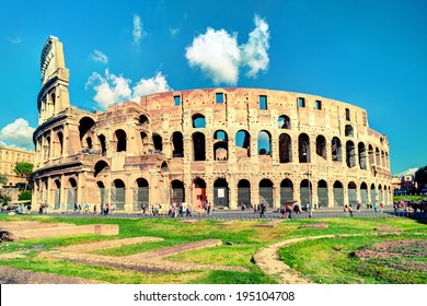 Colosseum or Coliseum in summer, Rome, Italy. Roman Colosseum is one of the main travel destinations in Europe. Beautiful view of Colosseum on a sunny day. Panorama of Colosseum in sunlight.