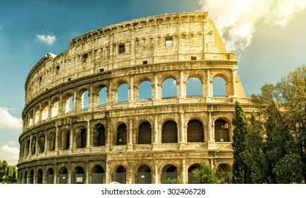 Colosseum or Coliseum in summer, Rome, Italy. Roman Colosseum is one of the main travel attractions of Rome. Ruins of Colosseum in sunlight. Sunny scenic view of ancient Colosseum. UNESCO site.