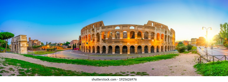 Colosseum and Constantine arch at sunrise in Rome, Italy