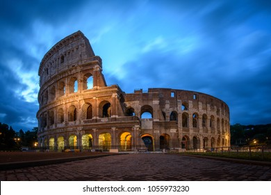 Colosseum during the evening with clouds moving in the sky in Rome, Italy. Roman Colosseum is a landmark and one of the best known monuments Italy and a UNESCO World Heritage Site. (0861)