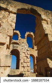 Colosseum in El Jem, Tunisia, Afrika. Collumns and blue sky, vertical.