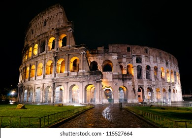 Colosseum at night, Rome, Italy. Roman Colosseum is one of the main travel attractions. Night illumination of Colosseum. Ancient ruins of Colosseum.