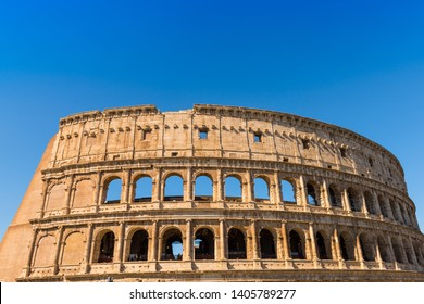 The Colosseum in Rome with blue sky, Italy