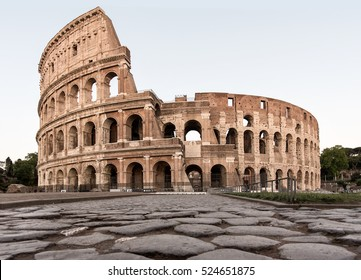 Colosseum in Rome from ground level along the old Roman Road during morning hours, bright and light. Italy, Landmark, Colloseum