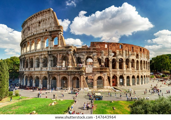Colosseum in Rome, Italy. Ancient Roman Colosseum is one of main tourist attractions in Europe. People visit the famous Colosseum in Roma city center. Scenic nice view of Colosseum ruins in summer.