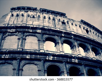Colosseum in Rome, Italy in black and white. Monochrome image filtered in faded, retro style with red filter and soft focus; nostalgic, vintage concept of travel. Low angle view.
