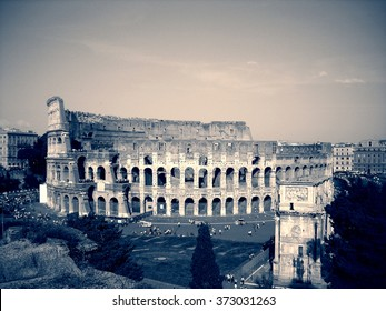 Colosseum in Rome, Italy in black and white. Monochrome image filtered in faded, retro style with red filter and soft focus; nostalgic, vintage concept of travel. Urban cityscape.