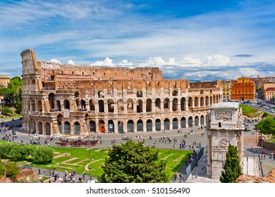 Colosseum in Rome, Italy with tourists on sunny bright day. The Colosseum was built in the 70s AD and was the largest amphitheatre built during the Roman Empire. Major Italian landmark.