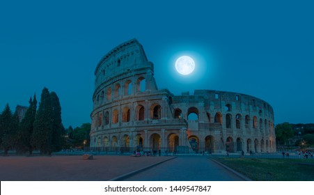 """Colosseum in Rome at night with full moon . Colosseum is the most landmark in Rome """"Elements of this image furnished by NASA"""
