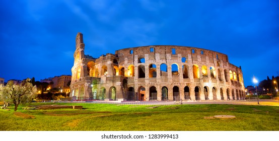 Colosseum in Rome panorama at dusk, Italy
