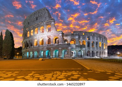 The Colosseum in Rome at sunrise, Italy