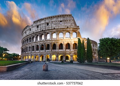 Colosseum in Rome at sunset with lights, Italy