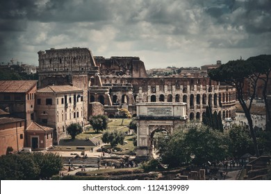 Colosseum ruins of historical buildings viewed from Rome Forum. Italy.