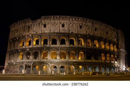 Colosseum in scaffolding at night in Rome, Italy