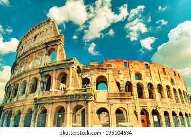 Colosseum in summer, Rome, Italy. Beautiful sunny view of Colosseum. Vintage photo. Roman Colloseum is one of the main travel destinations in Europe. Colloseum in the sunlight.