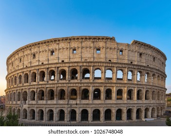 Colosseum at sunrise in Rome, Italy, Europe. Rome ancient arena of gladiator fights. Rome Colosseum is the best known landmark of Rome and Italy.