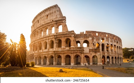 Colosseum at sunrise in Rome, Italy, Europe. Rome ancient arena of gladiator fights. Rome Colosseum is the best known landmark of Rome and Italy