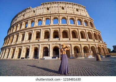 Colosseum and young tourist woman near gladiator arena famous ancient history roman empire architecture exterior theater historical travel tourism landmark ruin monument stadium building Italy Rome.
