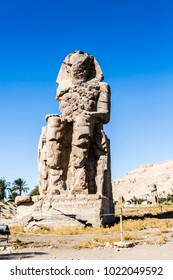 The Colossi of Memnon are two massive stone statues of the Pharaoh Amenhotep III, Luxor, Luxor Governorate