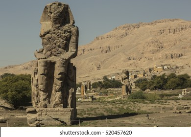 Colossus of Memnon - ancient Egyptian monument. Egypt, Luxor