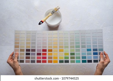 The colour of the enamel in his hands. The choice of paint color for the walls.