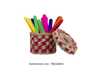 Colour ice cream sticks in rattan basket.