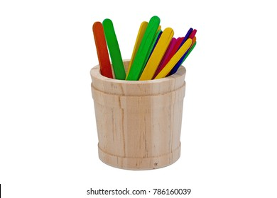 Colour ice cream sticks in wood basket.