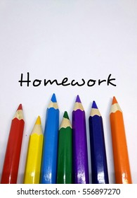Colour pencil concept with message of homework.  Colourful colour relates with student homework