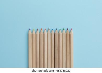 Colour pencils on pastel background.