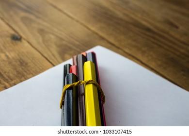 a colour pencils on a white paper
