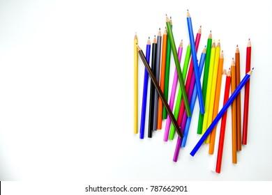 Colour pencils rainbow style, multicoloured pencils on white background. Close up. Selective focus.