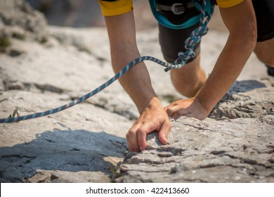 Colour picture of a climber on a stone wall